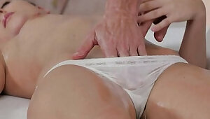 Hot brunette massaged and banged on table