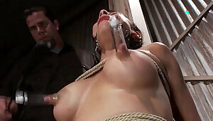 Tied up gagged sub getting whipped by her dominant master