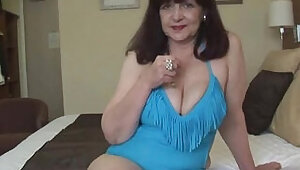 Attractive big tits lady in tight swimsuit playing on fitness ball